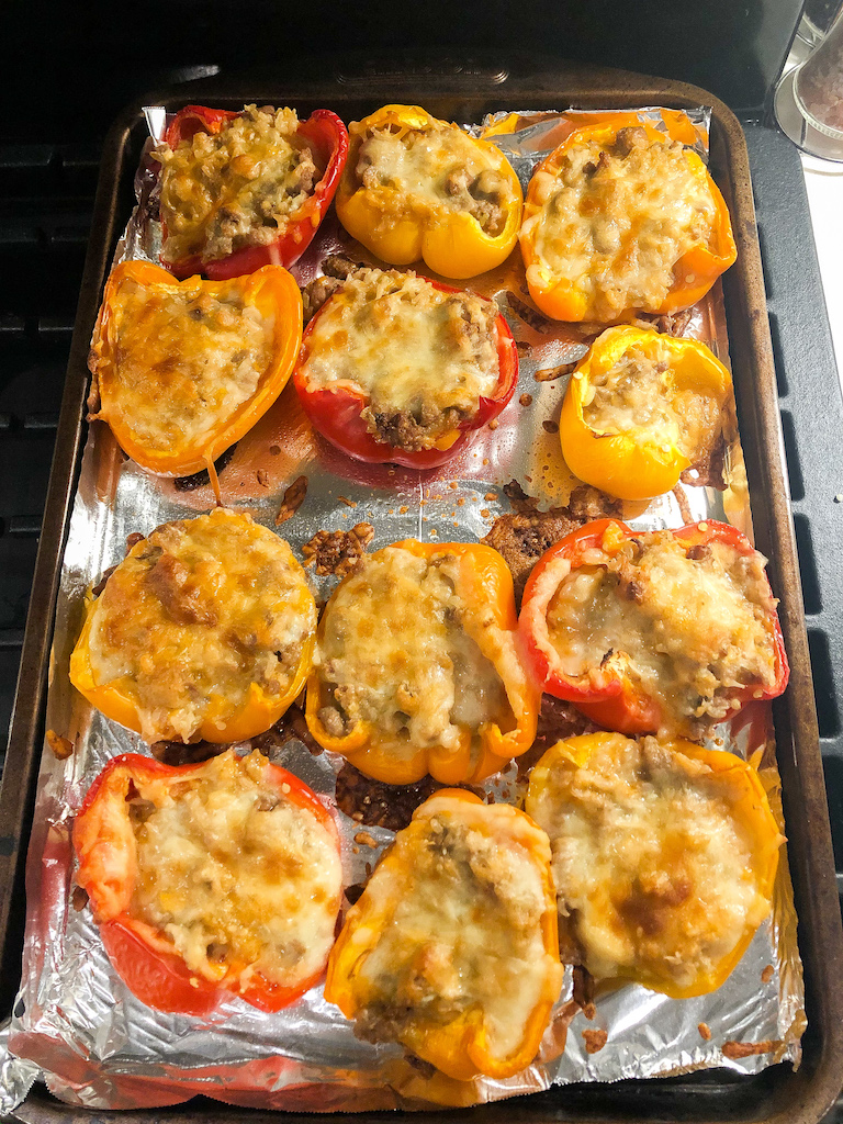 This recipe is a fresh spin on the classic stuffed peppers recipe [actually... it's 10x better!]. It's healthy, quick + easy to make, great for batch cooking + meal prepping, delicious reheated, great for kids, + a family favorite. Here is what's included: 6 organic peppers sliced in half, 1 cup cheddar, 1 cup mozzarella, 2tbsp coconut aminos, 1 cup cream cheese, 1 bag TJ bagged frozen organic brown rice, 1lb ground pork, 1tbsp garlic powder, + salt + pepper. The perfect lunch or dinner recipe!