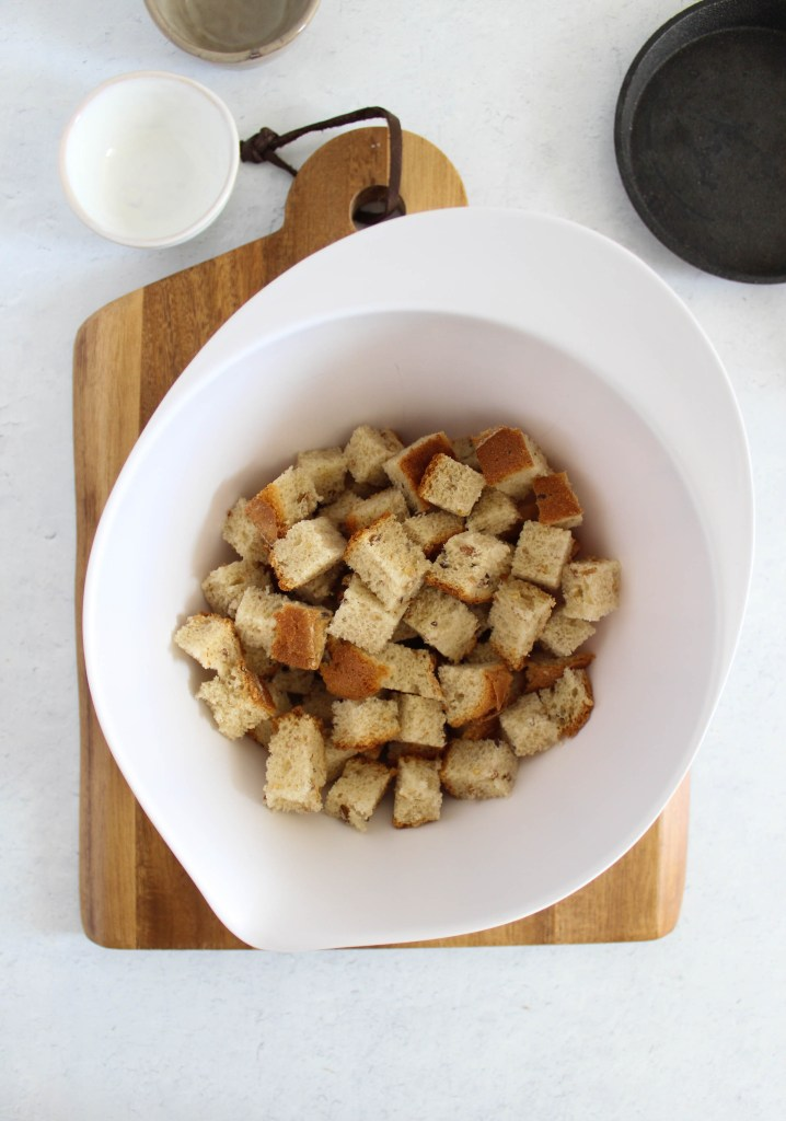 cubed bread in a bowl.