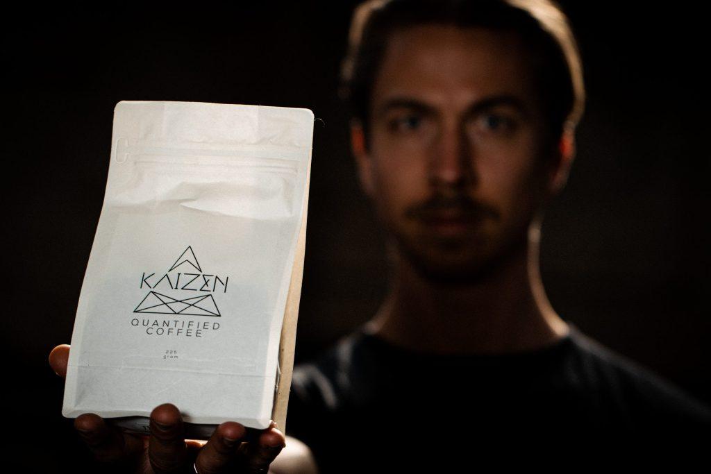 Govert Viergever holding Kaizen Coffee