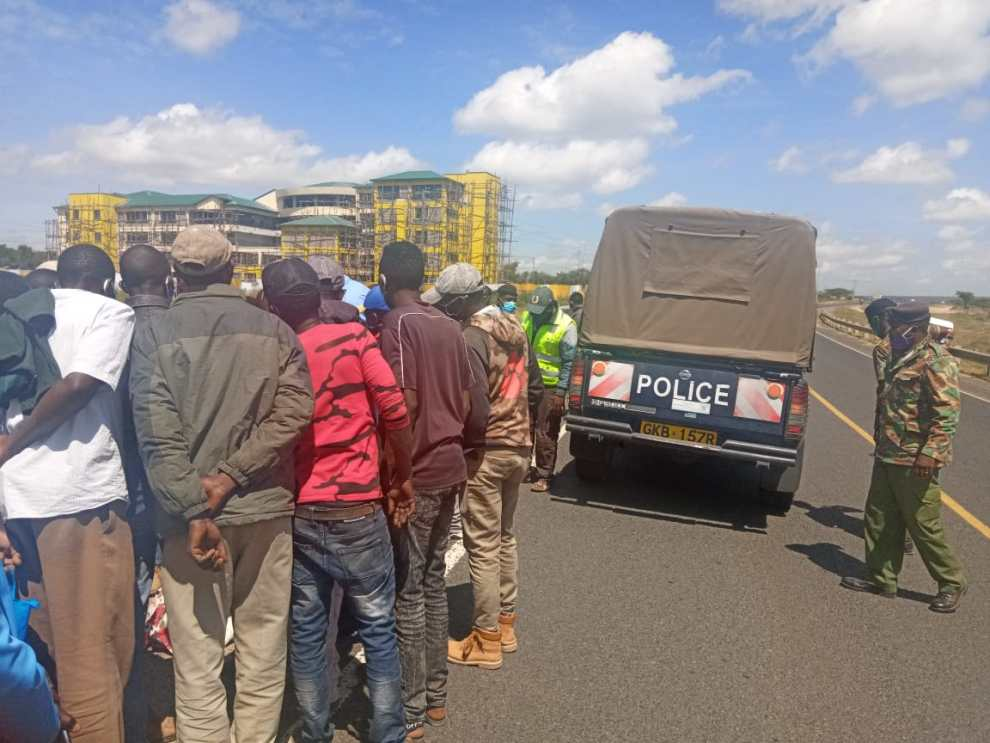 People look at the body of a woman alleged to had been hit by a moving car in Kajiado town on Thursday.jpeg