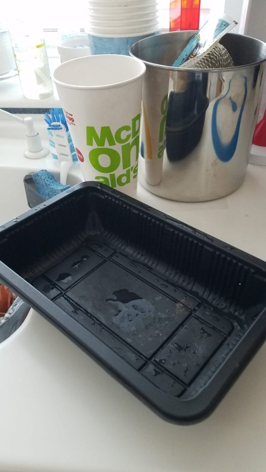 Photo of plastic lid to collect compost