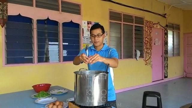 Nicholas cooks for the Penan children.