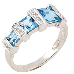 Bridges to stardom... glory and fame is not far when you dress like a star! 18K White Gold Ring with Blue Topaz and Diamonds.