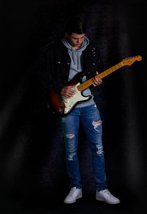 Kaleb playing electric guitar full body