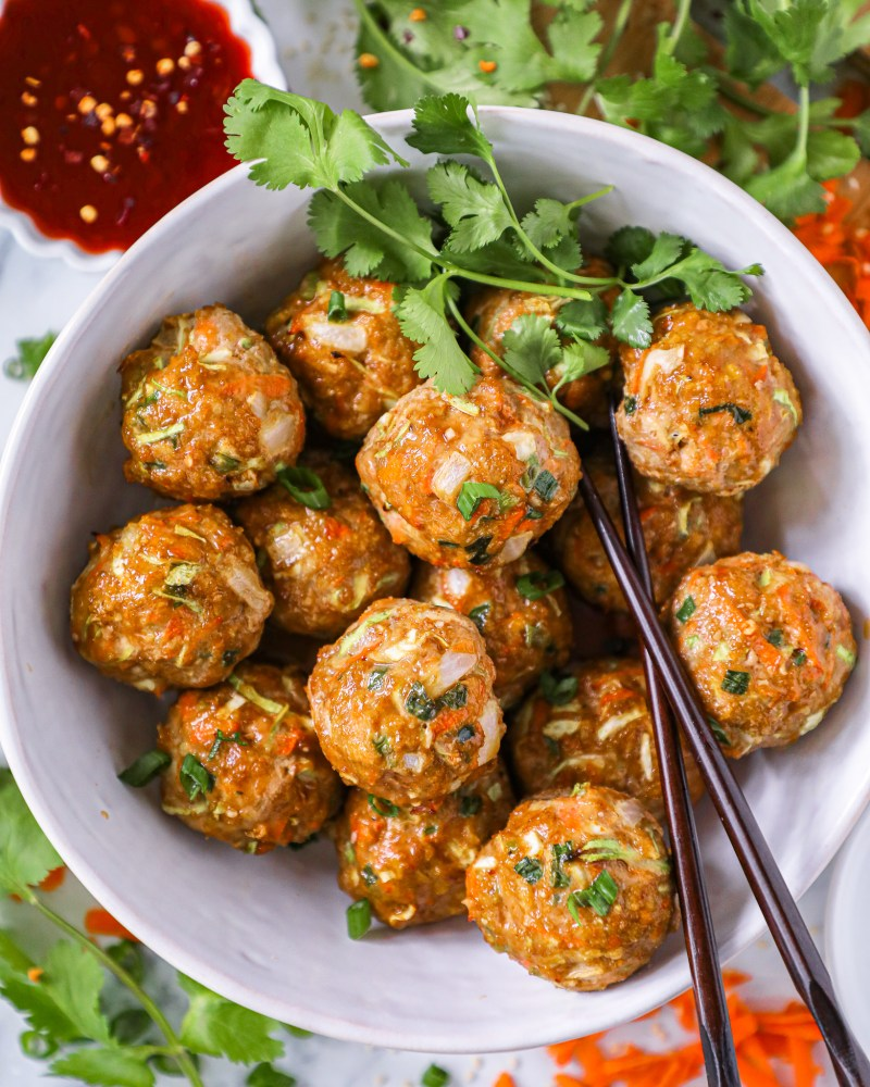 Easy oven baked egg roll meatballs are perfect for meal prepping or for a quick and easy weeknight meal! Plus there's even a recipe for my homemade sweet and spicy glaze too!