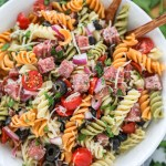 An easy pasta salad recipe made with rotini pasta noodles, salami, grape tomatoes, black olives, red onion, parmesan cheese and an easy homemade dressing!