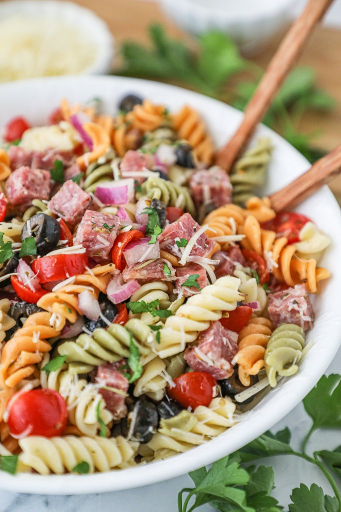 This lightened up pasta salad dish is just what you need this summer! It's so refreshing and has so much flavor, it's sure to be a crowd pleaser!