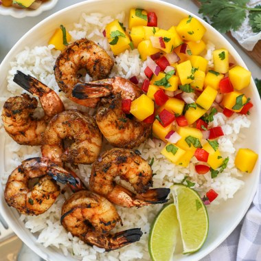 Incredibly easy jerk shrimp served with steamed white rice and a fresh mango salsa! This meal just screams summer!