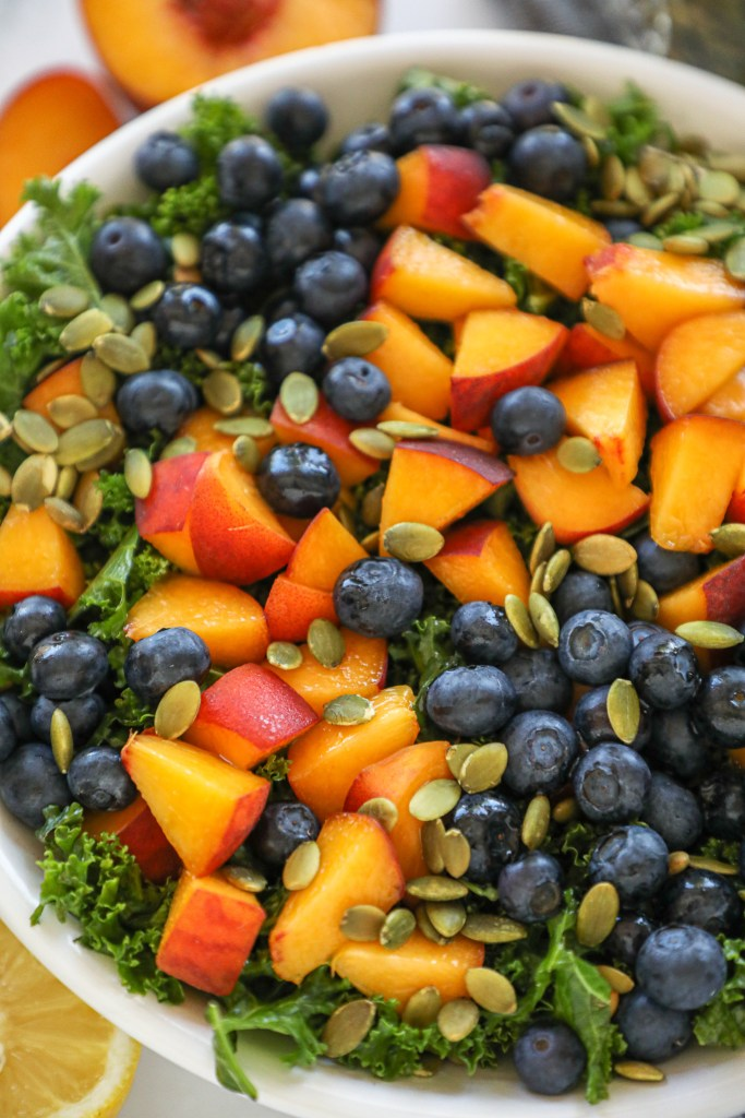 The ultimate summer kale salad! It's loaded with fresh fruit, can easily be made in advance and is always a hit at our summer potlucks! Plus it's full of flavor and so refreshing too!