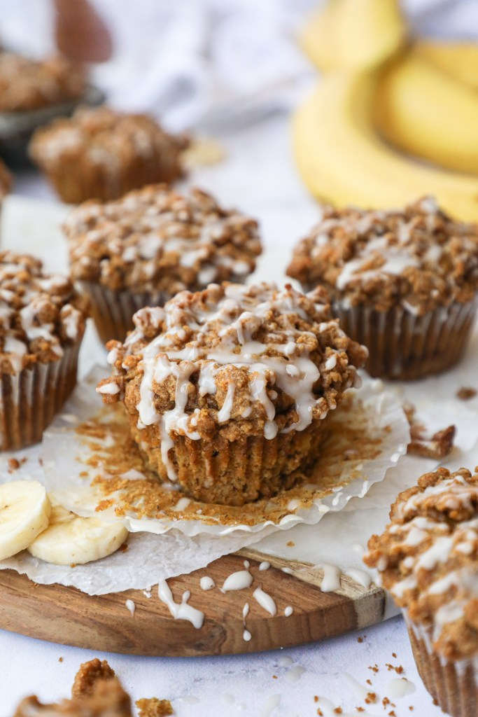 An easy muffin recipe that combines banana bread bread and coffee cake! They're incredibly moist and fluffy and full of cinnamon spice!