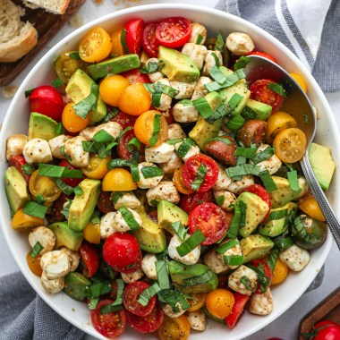Avocado, tomatoes, mozzarella and fresh basil are all tossed in a simple balsamic dressing with salt and pepper! It's the perfect side dish for any occasion!