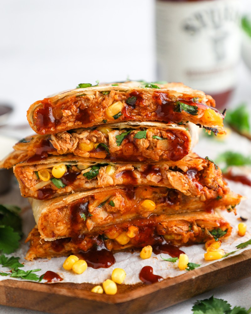 Flour tortillas are stuffed with bbq chicken, mozzarella cheese, sweet corn, red onion and cilantro and seared to crispy perfection! These quesadillas are such a fun spin on a classic!