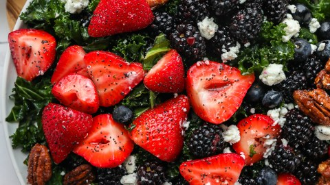 Tender kale is tossed with strawberries, blackberries, blueberries and goat cheese to make this delicious spring salad!