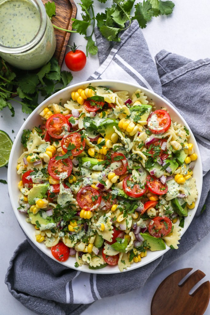 Cilantro lime pasta salad is the perfect side dish to serve this spring and summer! It's tangy, creamy and perfect for a crowd!