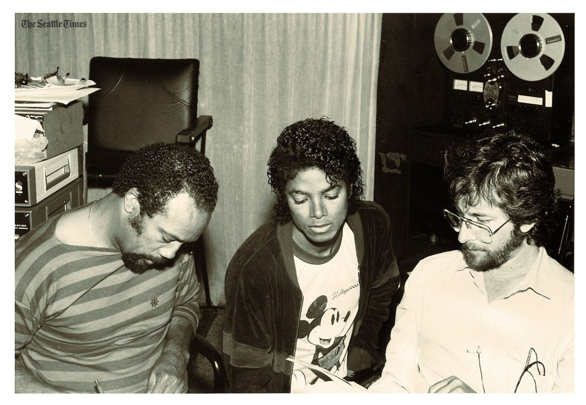 Jones, left, goes over material in the studio with Michael Jackson and Steven Spielberg. Jones had encouraged Jackson to sing rock-oriented material, which resulted in ''Thriller,'' the biggest-selling album of all time. Jones nicknamed Jackson ''Smelly'' because whenever the music became extra funky, Jackson would say ''give me some of that `smelly jelly.' '' pn07 Quin_Michael Story ID: Previous UID: 0406221245