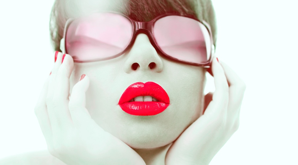 Glamour photo of red lipstick and red sunglasses of young woman