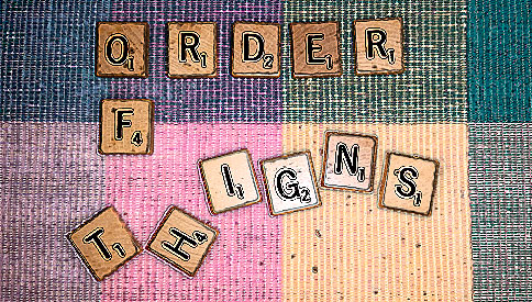 scrabble tiles spell order of t-h-i-g-n-s