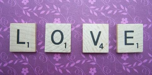 love spelled in scrabble tiles