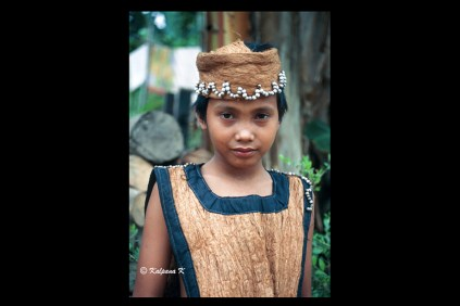Benuaq Dayak boy dressed in traditional bark cloth