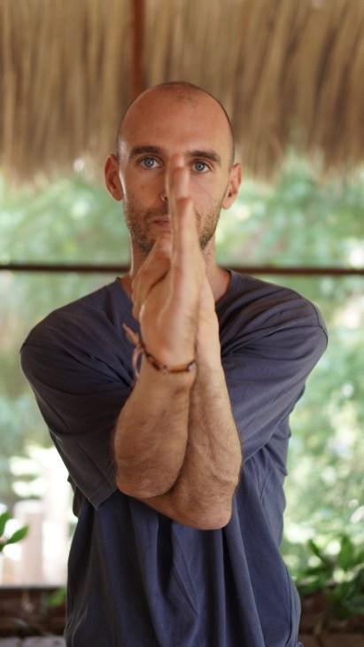 Adam performing an asana