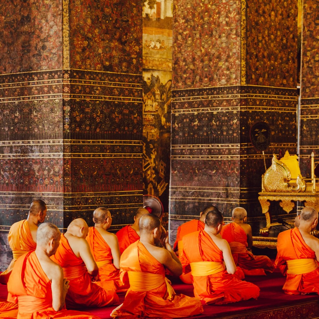monks seated in meditation