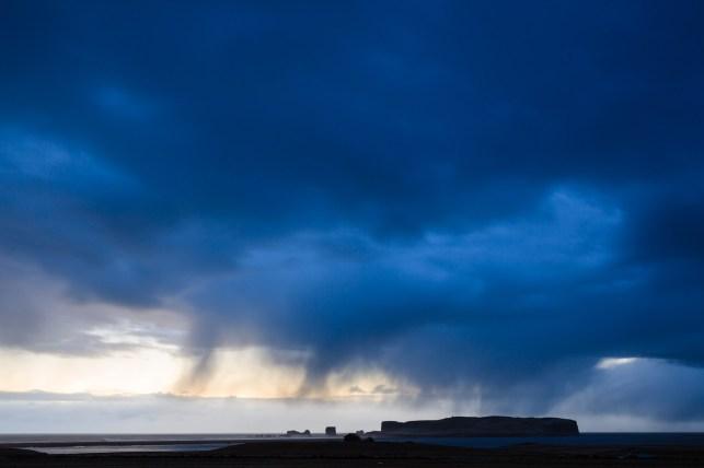 Sunset over the Vik coastline looking toward Dyrholaey. Vik. Iceland.