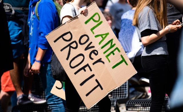 planet over profit sign