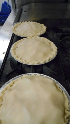 Pies bulging with fruit. All they need is the oven!