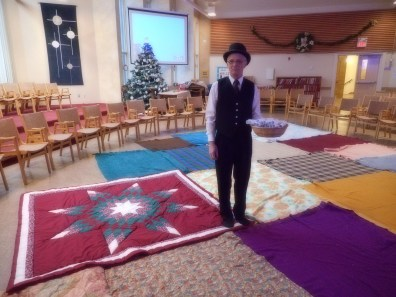"""Ian, as """"the European"""". At the left side of the photo is a """"star blanket"""", a gift to Karen McC when she worked with First Nations peoples in northern Manitoba."""