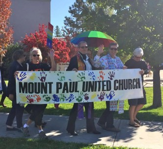 Barb, Ivy, LeAnn and Linda carry the Mt. Paul banner.