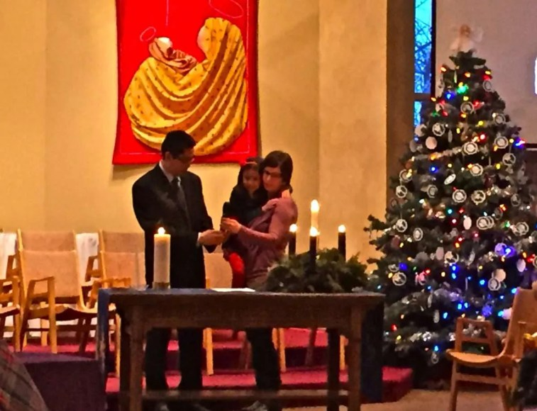 Syd, Shelley and Clare lighting the Christmas candles.