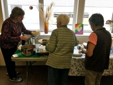 June, Dawne and Freda getting ready to sample their cooking.