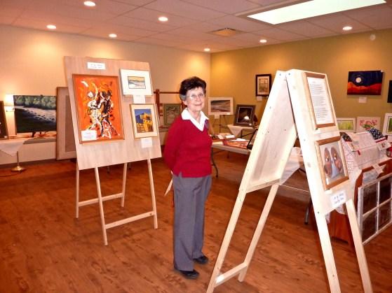 Barb enjoys the Art Show.