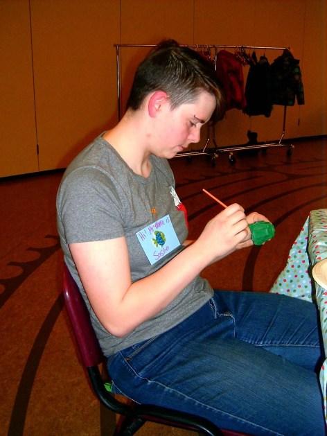 Sasha painting a turtle.