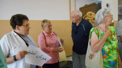 R.A.F.T. members Verna, Tacey and Sepke chat with KUC's Chuck. (RAFT = Refugees and Friends Together, a group made up of different church and secular folk, together with the KUC Refugee Resettlement Committee.)