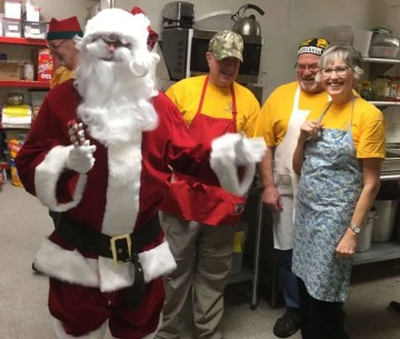 Santa and some of the Daybreak Rotary kitchen crew