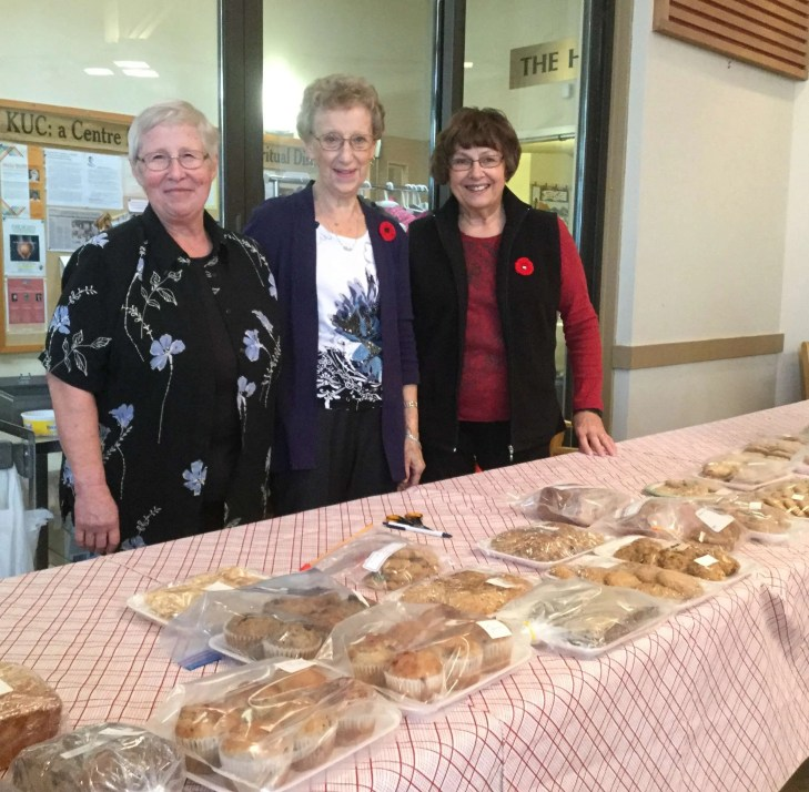 Heather, Doreen and Nancy on bake sale table