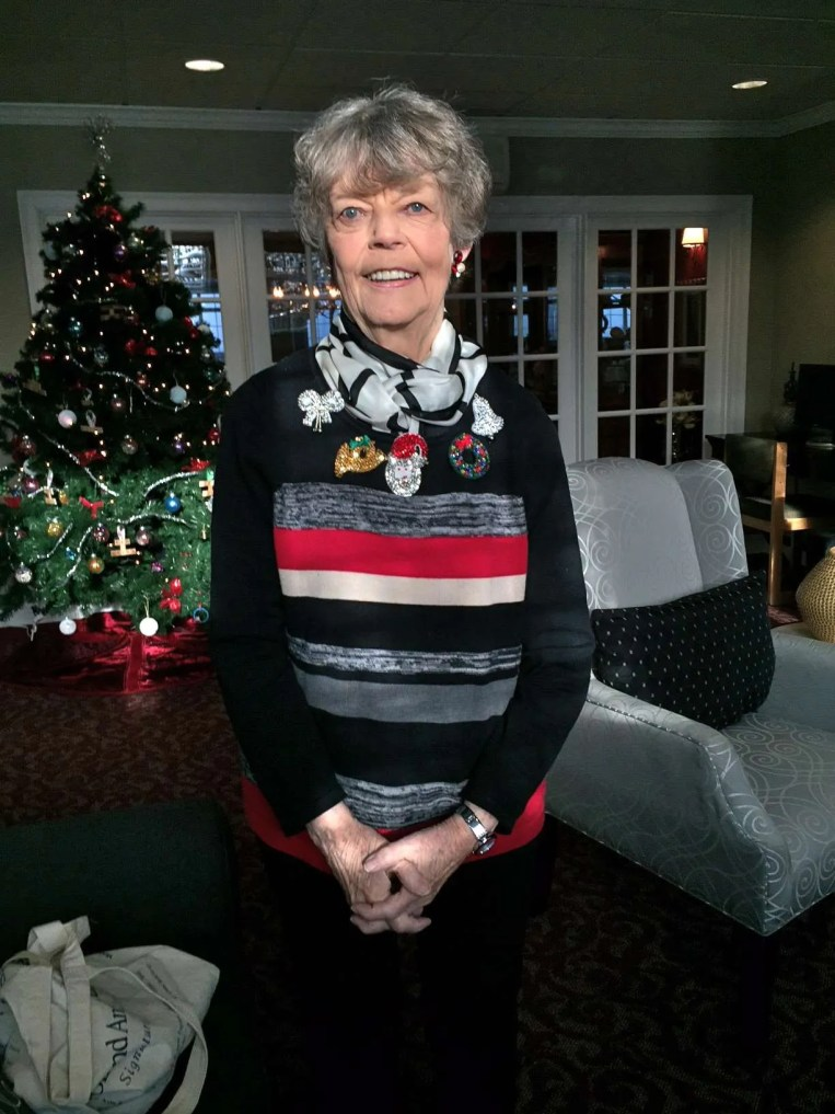 Lois wearing several of Irene Covington's pins!