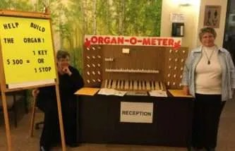 Organ-O-Meter, created by Karen and Sandy, to chart the fundraising for the Allen organ. Each key/pull shows $300 raised. The keys and pulls are all that are left of the former KUC organ.