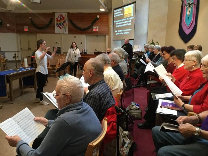 Mandy Maher rehearses with the choir.