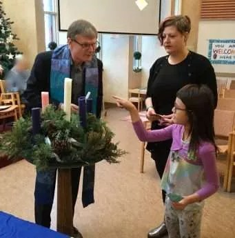 Eden lit the Advent Candle of Joy