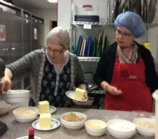 Carol and Ona mixing up the Black Forest batter.
