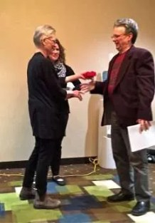 Medal presented to George by Joanne Broderud