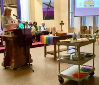 Chris sharing from the pulpit, our new Lenten banner and antependium and the beautiful rainbow communion runner.