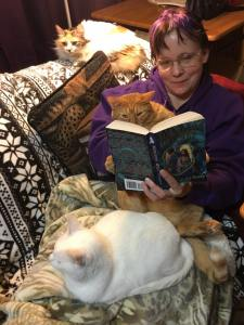 "img=""author with cats"""