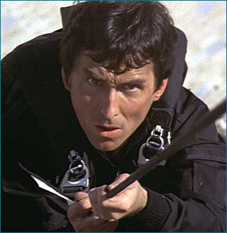 """Accompanied 002 and 007 to Gibraltar in The Living Daylights film; murdered by an individual pretending to be a KGB agent who left a tag on the body that read """"Death to Spies"""" in Russian."""