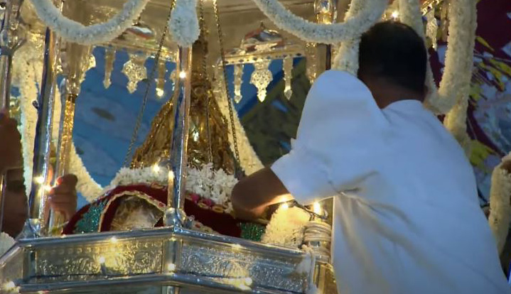 Placing the golden casket with the sacred tooth relic on the royal tusker