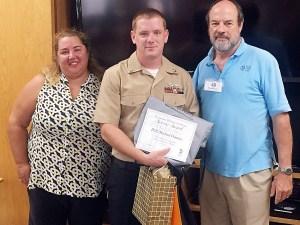 PO2 Michael Denney receives KBG Service Award (and appreciation goodies) as Junior Sailor of the Quarter.