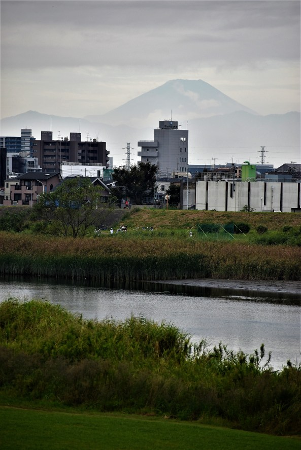 Mount Fuji overlooks the Tama River in Kawasaki