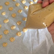 Pipe into pea-sized dots on a parchment paper lined baking sheet
